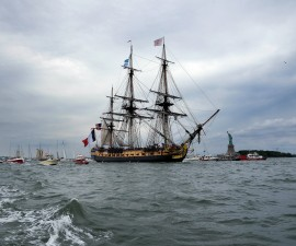 A replica of the Hermione, the 18th century ship that brought French General Lafayette to America, sails the waters off New York on July 4, 2015, leading a flotilla marking the US Independence Day. The faithful reproduction of the majestic French frigate glided past New York's famed Verrazano bridge, State of Liberty and Manhattan skyline, where it was joined by scores of other boats and ships. AFP PHOTO/JEWEL SAMAD        (Photo credit should read JEWEL SAMAD/AFP/Getty Images)