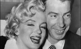 This April 1, 1954, photo shows actress Marilyn Monroe with her husband, baseball legend Joe DiMaggio during their wedding ceremony at San Francisco City hall. Watch video from that event, below. Photo by AFP/AFP/Getty Images