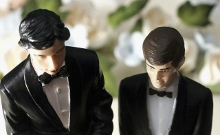 BIRMINGHAM, UNITED KINGDOM - DECEMBER 05:   in this photo illustration, same sex statues adorn the top of a wedding cake at a wedding specialists store on December 5, 2005, Birmingham, England. The Civil Partnership Act came into force today allowing same sex couples who want to form a legal partnership the same legal rights as married couples in matters including inheritance, pension provisions and next of kin.  (Photo by illustration Christopher Furlong/Getty Images)