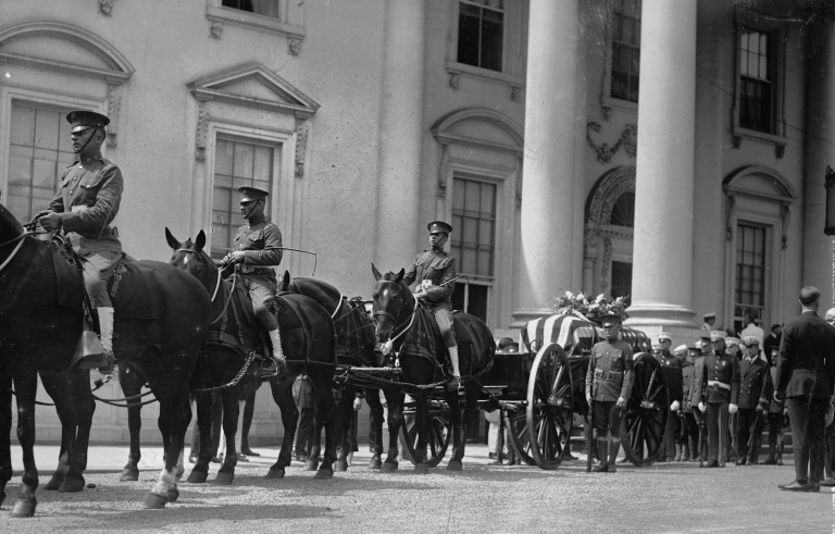Funeral of US President Warren G. Harding. Horse drawn coffin in procession outside of the White House. Photo from Library of Congress