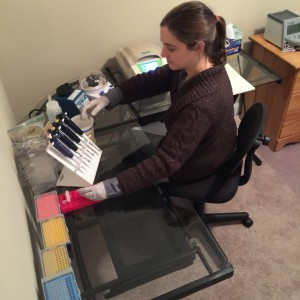 A photo of Dash Masland in her lab - built from used equipment purchased off ebay. Dash's artistic process requires a common biochemistry technique known as polymerase chain reaction.