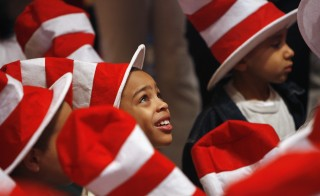 "Children listen as Dr. Seuss books are read during ""Read Across America Day"" in New York on March 2, 2007. Photo by Lucas Jackson/Reuters"