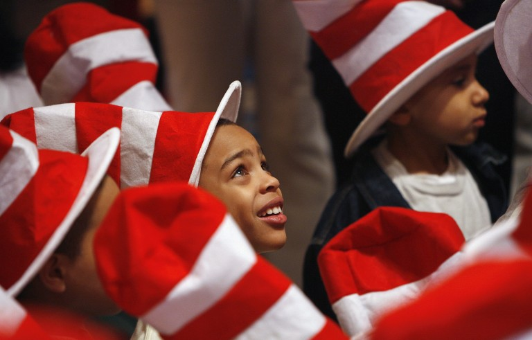 """Children listen as Dr. Seuss books are read during """"Read Across America Day"""" in New York on March 2, 2007. Photo by Lucas Jackson/Reuters"""