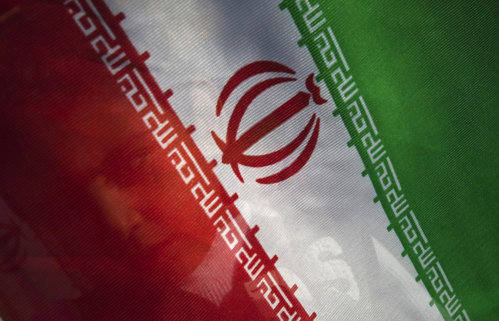 It is likely that Iran, whose flag is pictured above, has violated a U.N. Security Council resolution by firing a ballistic missile. REUTERS/Morteza Nikoubazl (IRAN - Tags: POLITICS RELIGION IMAGES OF THE DAY) - RTR2DHZS