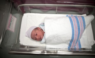 Newborn baby Makenzie, daughter of Stephanie Sanchez, 25, and Kenneth Vega, is wheeled to a nursery after she was born at 10:25am at Wyckoff Heights Medical Center in the Brooklyn borough of New York October 31, 2011. Photo by Lucas Jackson/Reuters