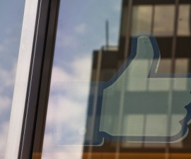 """The Facebook """"Like"""" icon is displayed in a window at the offices of J.P. Morgan in New York City, New York May 4, 2012. Facebook Inc aims to raise about $10.6 billion in Silicon Valley's largest IPO, dwarfing the coming-out parties of tech companies like Google Inc and granting the world's largest social network a market value close to Amazon.com's.REUTERS/Lee Celano (UNITED STATES - Tags: BUSINESS SCIENCE TECHNOLOGY) - RTR31M4J"""