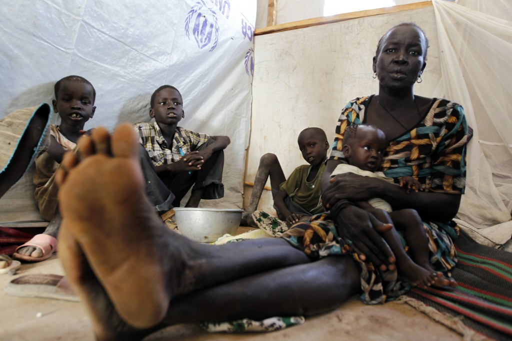 Refugees from Jonglei State in South Sudan wait at a registration center in Kakuma refugee camp in Turkana District, northwest of Kenya's capital Nairobi, on May 17, 2012. Refugees fleeing violence in parts of Sudan and South Sudan have been arriving in Kakuma refugee camp in large numbers. Photo by Thomas Mukoya/Reuters