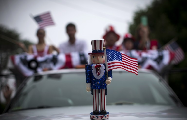 An Uncle Sam figure sits on the hood of a car in a July Fourth parade in the village of Barnstable, Massachusetts July 4, 2014. Barnstable, which is located on Cape Cod in Massachusetts and was first settled in 1639, is celebrating its 375th anniversary in 2014.   REUTERS/Mike Segar  (UNITED STATES - Tags: ANNIVERSARY SOCIETY) - RTR3X42M