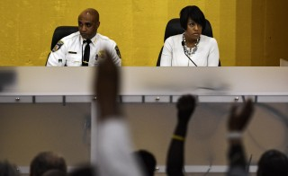 Baltimore Mayor Stephanie Rawlings-Blake (R) and Police Commissioner Anthony Batts take questions at a community meeting about new youth curfew legislation going into effect on August 8 at the University of Baltimore Law Center in Baltimore Tuesday July 29, 2014. Baltimore, faced with high crime rates, is set to impose one of the strictest U.S. curfews for young people, with the mayor facing residents on Tuesday to explain the new rules. REUTERS/James Lawler Duggan   (UNITED STATES - Tags: POLITICS CRIME LAW) - RTR40KXR