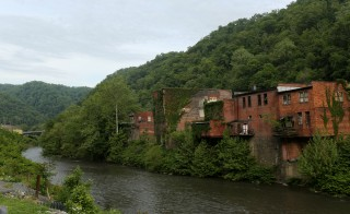 A view of the Tug river running through downtown Iaeger, West Virginia May 20, 2014. With coal production slowing due to stricter environmental controls, the availability of natural gas and a shift to surface mining, the state's coal country has been hit hard with job losses and business closures. Picture taken May 20, 2014. Photo by Robert Galbraith/Reuters