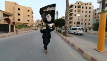 "A member loyal to the Islamic State in Iraq and the Levant (ISIL) waves an ISIL flag in Raqqa June 29, 2014. The offshoot of al Qaeda which has captured swathes of territory in Iraq and Syria has declared itself an Islamic ""Caliphate"" and called on factions worldwide to pledge their allegiance, a statement posted on jihadist websites said on Sunday. The group, previously known as the Islamic State in Iraq and the Levant (ISIL), also known as ISIS, has renamed itself ""Islamic State"" and proclaimed its leader Abu Bakr al-Baghadi as ""Caliph"" - the head of the state, the statement said. REUTERS/Stringer (SYRIA - Tags: POLITICS CIVIL UNREST )  BEST QUALITY AVAILABLE - RTR4BHO3"