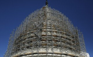File photo of U.S. capitol dome covered in scaffolding by Gary Cameron/Reuters