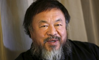 Dissident Chinese artist Ai Weiwei speaks during an interview with Reuters at his hotel in Beijing