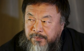 Dissident Chinese artist Ai Weiwei speaks during an interview with Reuters at the hotel he is staying at in Beijing