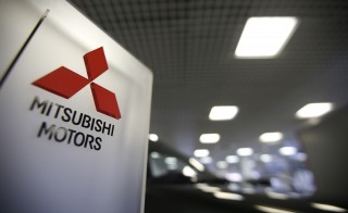 The logo of Mitsubishi Motors is seen on a board at a showroom of the Avtomir company, a Mitsubishi cars dealership, in Moscow, April 1, 2015. Mitsubishi Materials Corp., another branch of the Mitsubishi name, apologized to American prisoners of war on Sunday for forcing around 500 of them to work as laborers in their mines during World War II. Photo by Maxim Zmeyev/Reuters