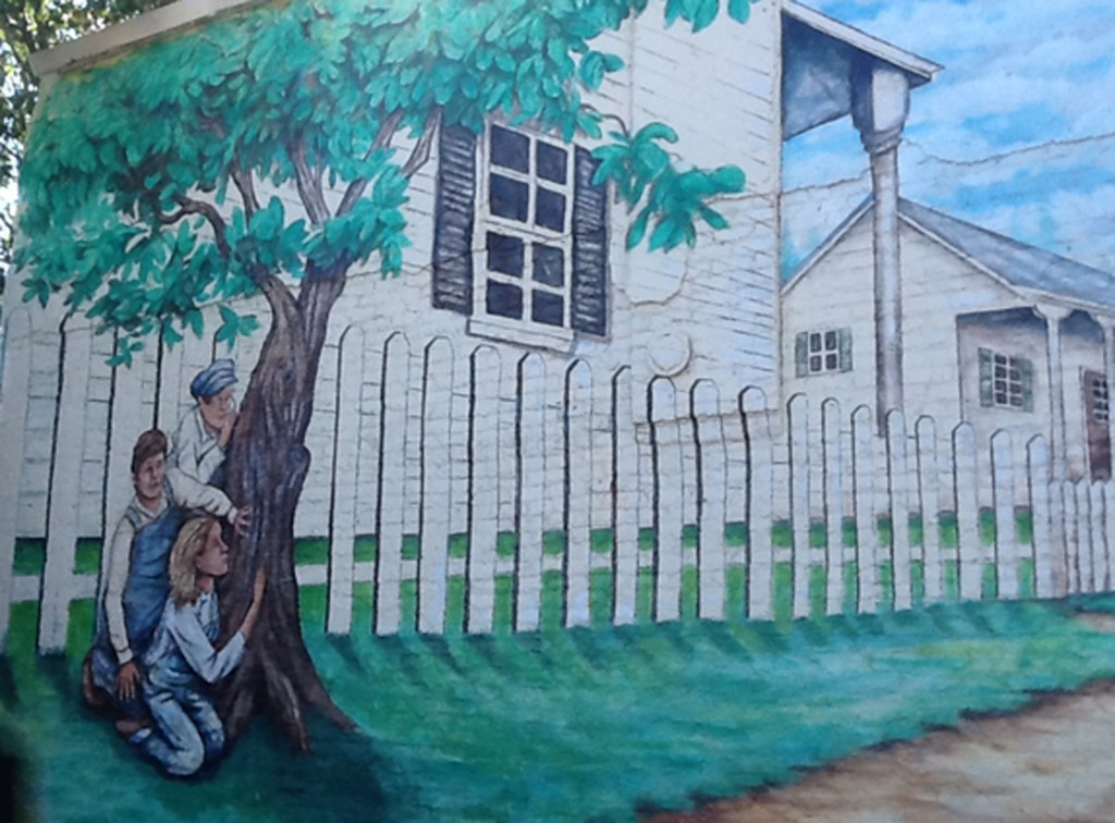 "A mural showing a scene from the 1960 bestseller ""To Kill A Mockingbird"" was painted on a building near home Harper Lee in Monroeville, Alabama. Photo by Verna Gates/Reuters"