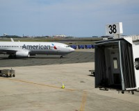 "An American Airlines plane pulls up to a gate at Logan Airport in Boston, Massachusetts, United States June 13, 2015. Outdoor scenes in Boston show local residents enjoying balmy weather amid lush greenery as the summer solstice approaches on 21 June. The very same locations suffered heavy snowstorms last winter, with snow ploughs, skiers and snowboarders battling the drifts. Boston got 275.8 cm of snow over the winter, the most since 1872, when records began. A few months after the snowstorms, Brian Snyder revisited the same places and shot pictures at exactly the same locations. REUTERS/Brian Snyder   PICTURE 30 OF 30 FOR WIDER IMAGE STORY ""WINTER FREEZE, SUMMER SOLSTICE""  SEARCH ""BRIAN SOLSTICE"" FOR ALL IMAGES - RTX1H85Y"