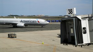 "An American Airlines plane pulls up to a gate at Logan Airport in Boston, Massachusetts, United States June 13, 2015. Outdoor scenes in Boston show local residents enjoying balmy weather amid lush greenery as the summer solstice approaches on 21 June. The very same locations suffered heavy snowstorms last winter, with snow ploughs, skiers and snowboarders battling the drifts. Boston got 275.8 cm of snow over the winter, the most since 1872, when records began. A few months after the snowstorms, Brian Snyder revisited the same places and shot pictures at exactly the same locations. REUTERS/Brian SnyderPICTURE 30 OF 30 FOR WIDER IMAGE STORY ""WINTER FREEZE, SUMMER SOLSTICE"" SEARCH ""BRIAN SOLSTICE"" FOR ALL IMAGES - RTX1H85Y"