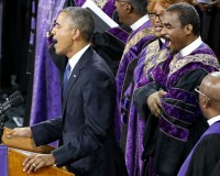 "U.S. President Barack Obama  leads mourners in singing the song ""Amazing Grace"" as he delivers a eulogy in honor of the Rev. Clementa Pinckney during funeral services for Pinckney in Charleston, South Carolina June 26, 2015. Pinckney is one of nine victims of a mass shooting at the Emanuel African Methodist Episcopal Church.   REUTERS/Jonathan Ernst - RTX1HZDH"