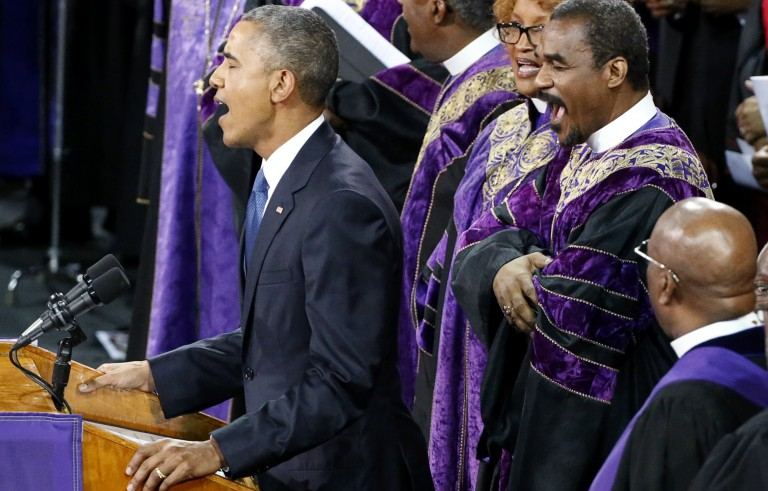 """U.S. President Barack Obama  leads mourners in singing the song """"Amazing Grace"""" as he delivers a eulogy in honor of the Rev. Clementa Pinckney during funeral services for Pinckney in Charleston, South Carolina June 26, 2015. Pinckney is one of nine victims of a mass shooting at the Emanuel African Methodist Episcopal Church.   REUTERS/Jonathan Ernst - RTX1HZDH"""