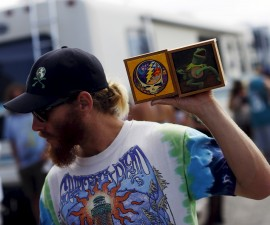 """A fan holds handmade memorabilia in the parking lot before Grateful Dead's """"Fare Thee Well"""" tour in Santa Clara, California, last month. Photo by Stephen Lam/Reuters"""