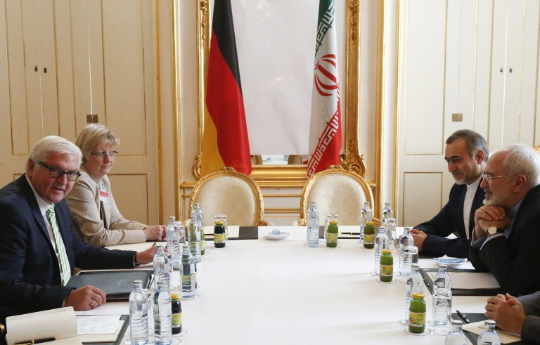 German Foreign Minister Frank-Walter Steinmeier (left) and Iranian Foreign Minister Javad Zarif wait for the start of a bilateral meeting in Palais Coburg, the venue for nuclear talks in Vienna, Austria, on July 2. Iran and six world powers gave themselves an extra week to reach a final nuclear accord after it became clear they would miss a deadline on Tuesday. Photo by Leonhard Foeger/Reuters