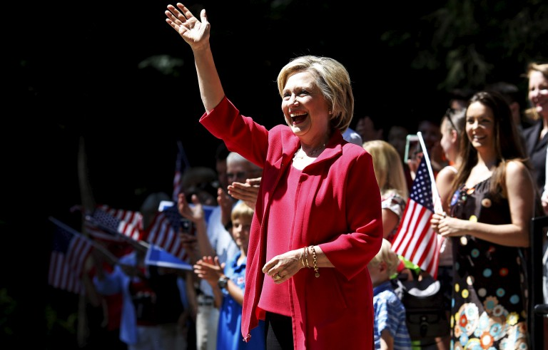 Former United States Secretary of State and Democratic presidential candidate Hillary Clinton smiles on stage during a campaign event in Hanover, New Hampshire, United States, July 3, 2015. REUTERS/Dominick Reuter - RTX1IY4X