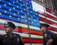 Police officers patrol Times Square in New York, United States, July 3, 2015. New York Governor Andrew Cuomo on Friday ordered heightened security measures across the state over the U.S. July Fourth holiday weekend in response to a call for vigilance by the federal government. REUTERS/Andrew Kelly - RTX1IYAD