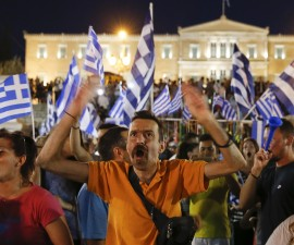 "Anti-austerity 'No' voters celebrate in front of the Greek parliament in Syntagma Square in Athens, Greece July 5, 2015. Greeks voted overwhelmingly ""No"" on Sunday in a historic bailout referendum, partial results showed, defying warnings from across Europe that rejecting new austerity terms for fresh financial aid would set their country on a path out of the euro.   REUTERS/Marko Djurica  - RTX1J4CI"