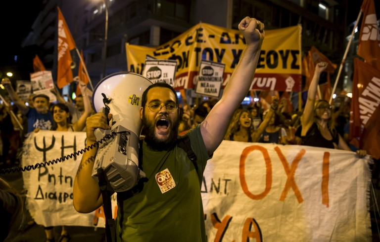 """No"" supporters celebrate on a street in central in Athens, Greece July 5, 2015. Greeks voted overwhelmingly ""No"" on Sunday in a historic bailout referendum, partial results showed, defying warnings from across Europe that rejecting new austerity terms for fresh financial aid would set their country on a path out of the euro. REUTERS/Marko Djurica - RTX1J4HW"