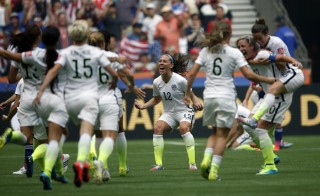 Jul 5, 2015; Vancouver, British Columbia, CAN; United States midfielder Lauren Holiday (12) celebrates with teammates after defeating Japan in the final of the FIFA 2015 Women's World Cup at BC Place Stadium. United States won 5-2. Mandatory Credit: Michael Chow-USA TODAY Sports  - RTX1J57P