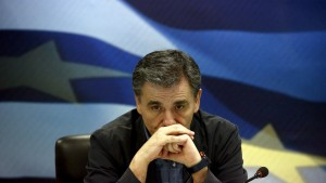 Newly-appointed Finance Minister Euclid Tsakalotos reacts during a handover ceremony in Athens, Greece July 6, 2015. Greece's top negotiator in aid talks with creditors, Euclid Tsakalotos, was sworn in as finance minister on Monday after the resignation of Yanis Varoufakis.  REUTERS/Yannis Behrakis - RTX1JAIR
