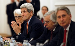 U.S. Secretary of State John Kerry  meets with foreign ministers of Germany, France, China, Britain, Russia and the European Union during the Iran Talks meetings at a hotel in Vienna, Austria July 7, 2015. A dispute over U.N. sanctions on Iran's ballistic missile programme and a broader arms embargo were among issues holding up a nuclear deal between Tehran and six world powers on Monday, the day before their latest self-imposed deadline. Photo by Carlos Barria /Reuters