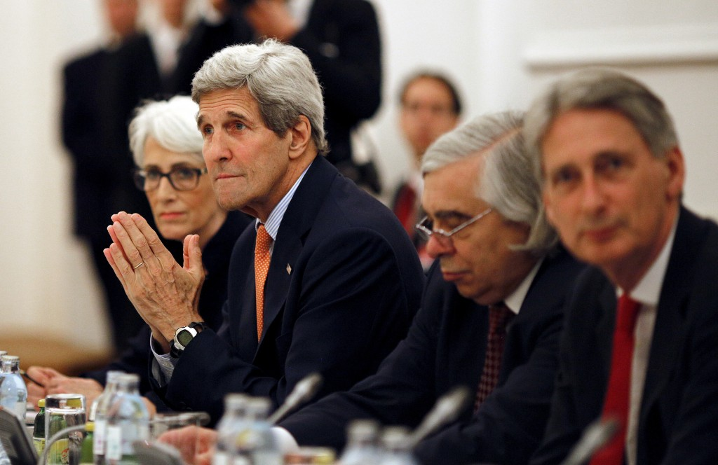 U.S. Secretary of State John Kerry  meets with foreign ministers of Germany, France, China, Britain, Russia and the European Union during the Iran Talks meetings at a hotel in Vienna, Austria July 7, 2015. A dispute over U.N. sanctions on Iran's ballistic missile programme and a broader arms embargo were among issues holding up a nuclear deal between Tehran and six world powers on Monday, the day before their latest self-imposed deadline. Photo by Carlos Barria/Reuters