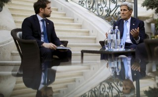 U.S. Secretary of State John Kerry (R) talks to State Department Chief of Staff Jon Finer during a meeting with members of the U.S. delegation at the garden of the Palais Coburg hotel where the Iran nuclear talks meetings are being held in Vienna, Austria July 10, 2015. Iran and major powers gave themselves until Monday to reach a nuclear agreement, their third extension in two weeks, as Tehran accused the West of throwing up new stumbling blocks to a deal. REUTERS/Carlos Barria  - RTX1JX57