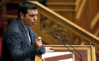 Greek Prime Minister Alexis Tsipras delivers his speech as he attends a parliamentary session in Athens, Greece, July 10, 2015. Tsipras appealed to his party's lawmakers on Friday to back a tough reforms package after abruptly offering last-minute concessions to try to save the country from financial meltdown.           REUTERS/Christian Hartmann  - RTX1JXVY