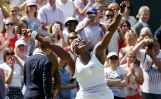 Serena Williams of the U.S.A celebrates after winning her Women's Final match against Garbine Muguruza of Spain at the Wimbledon Tennis Championships in London, July 11, 2015.                                              REUTERS/Suzanne Plunkett  - RTX1JZWD