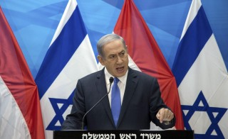 Israel's Prime Minister Benjamin Netanyahu delivers a statement to the media in Jerusalem on July 14. He described the agreement reached on Tuesday by Iran and major world powers on Tehran's nuclear program as a historic mistake and said he would do what he could to block Iran's nuclear ambitions. Photo by Ahikam Seri/Pool via Reuters