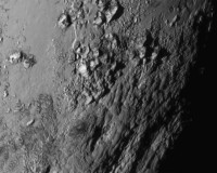 A new close-up image of a region near Pluto?s equator reveals a range of youthful mountains rising as high as 11,000 feet (3,500 meters) above the surface of the icy body, in a picture released by NASA in Laurel, Maryland July 15, 2015.  A U.S. spacecraft sailed past the tiny planet Pluto in the distant reaches of the solar system on Tuesday, capping a journey of 3 billion miles (4.88 billion km) that began nine and a half years ago. NASA's New Horizons spacecraft passed by the ice-and-rock planetoid and its entourage of five moons at 7:49 a.m. EDT (1149 GMT). The event culminated an initiative to survey the solar system that the space agency embarked upon more than 50 years ago.  REUTERS/NASA New Horizons/Handout via Reuters   TPX IMAGES OF THE DAY. THIS IMAGE HAS BEEN SUPPLIED BY A THIRD PARTY. IT IS DISTRIBUTED, EXACTLY AS RECEIVED BY REUTERS, AS A SERVICE TO CLIENTS. FOR EDITORIAL USE ONLY. NOT FOR SALE FOR MARKETING OR ADVERTISING CAMPAIGNS - RTX1KFQC