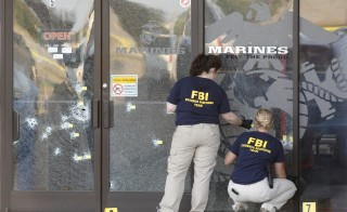 FBI agents work the scene at the Armed Forces Career Center in Chattanooga, Tennessee July 16, 2015. Four Marines were killed on Thursday by a gunman who opened fire at two military offices in Chattanooga, Tennessee, before being fatally shot in an attack officials called a brazen, brutal act of domestic terrorism. Photo by Tami Chappell/Reuters