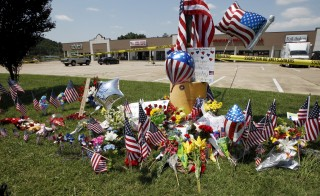Items left at a memorial at the Armed Forces Career Center are seen in Chattanooga, Tennessee, on July 17, 2015. Four U.S. Marines were killed on Thursday by Muhammad Abdulazeez, who opened fire at two military offices in Chattanooga before being fatally shot by police. A fifth victim, Naval petty officer Randall Smith, died of his injuries early  Saturday.   Photo by Tami Chappell/Reuters