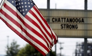 The U.S. flag flies alongside a sign in honor of the five Marines killed in Chattanooga, Tennessee, on July 17, 2015. The fatal shooting is an example of the kind of domestic terror that the FBI has worried about in recent years. Photo by Tami Chappell/Reuters