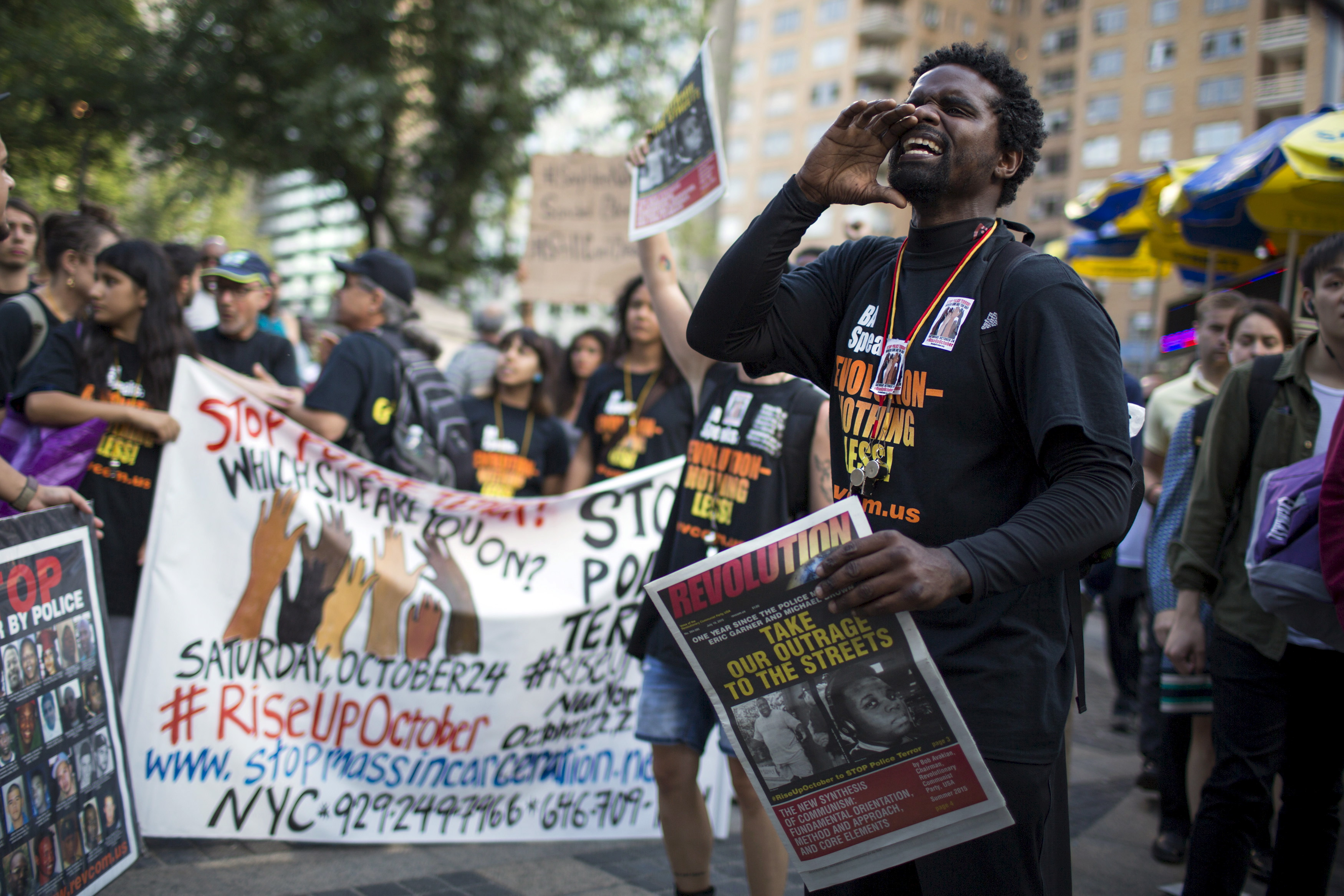 A protester shouts slogans against the New York Police Department during a July 17 rally for Eric Garner, who was killed one year ago by police in New York. Family and supporters on Friday marked the anniversary with rallies and vigils. Photo by Eduardo Munoz/Reuters