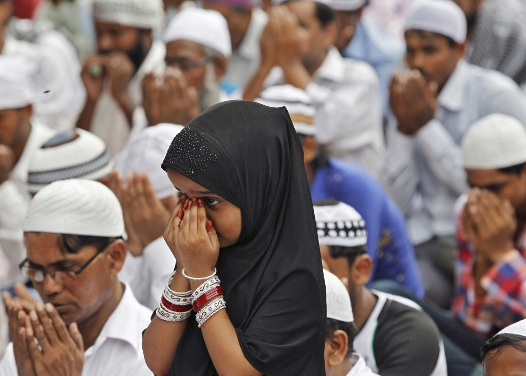 A Muslim girl offers prayers on the occasion of Eid al-Fitr in Chandigarh, India on July 18, 2015.  Photo by Ajay Verma/Reuters