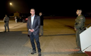 Defense Secretary Ash Carter pauses on the tarmac before boarding a plane to Israel, Andrews Air Force Base, Maryland, July 19, 2015. Officials say Washington has no plans to offer new weaponry as compensation for the Iran deal. Photo by Carolyn Kaster/Reuters