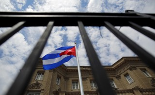 The Cuban national flag is seen raised over their newly reopened embassy in Washington, July 20, 2015. The Cuban flag was raised over Havana's embassy in Washington on Monday for the first time in 54 years as the United States and Cuba formally restored relations, opening a new chapter of engagement between the former Cold War foes. Photo by Carlos Barria/Reuters
