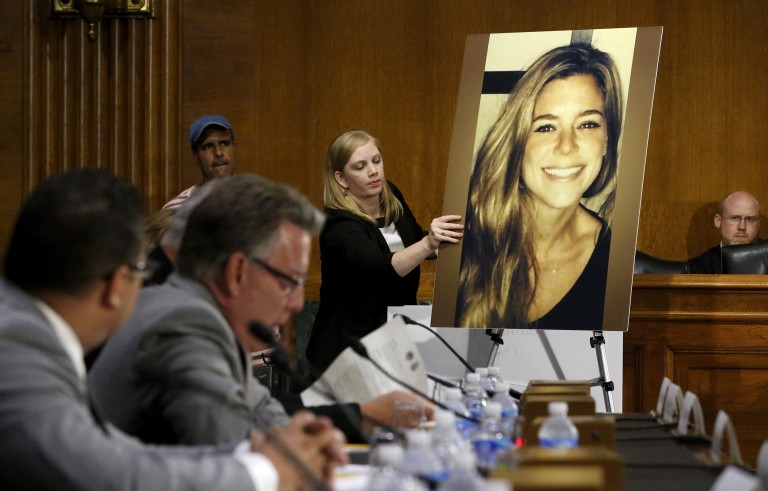 A photo of murder victim Kathryn Steinle (R), allegedly killed at the hands of an undocumented immigrant, is placed on an easel as her father Jim Steinle (2nd L) prepares to testify about her murder during a hearing of the Senate Judiciary Committee on U.S. immigration enforcement policies, on Capitol Hill in Washington on July 21, 2015. Photo by Jonathan Ernst/Reuters