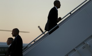 U.S. President Barack Obama boards Air Force One for travel to Kenya and Ethiopia from Joint Base Andrews, Maryland on July 23, 2015. Obama will land in Kenya on Friday with a mission to strengthen U.S. security and economic ties, but his personal connection to his father's birthplace will dominate a trip that Kenyans view as a native son returning home. Photo by Jonathan Ernst/Reuters