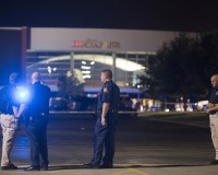 "Officials stand by the scene outside the movie theatre where a man opened fire on film goers in Lafayette, Louisiana July 23, 2015. A gunman opened fire at a movie theater in Lafayette, Louisiana, on Thursday evening, killing at least two persons and injuring nine others before taking his own life, according to a local ambulance company. The shooting took place during a 7 p.m. CDT (0000 GMT) showing of the film ""Train Wreck"" in a shooting that took place almost three years to the day after a movie theater rampage in Aurora, Colorado, police and media reported. REUTERS/Lee Celano - RTX1LLF9"