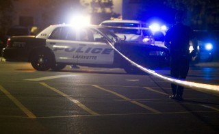 Police stand by at the scene outside the movie theatre where a man opened fire on film goers in Lafayette, Louisiana on July 23, 2015. The 58-year-old gunman opened fire inside a crowded movie theatre Thursday evening, killing two people and injuring nine others before taking his own life, police said. Photo by Lee Celano/Reuters